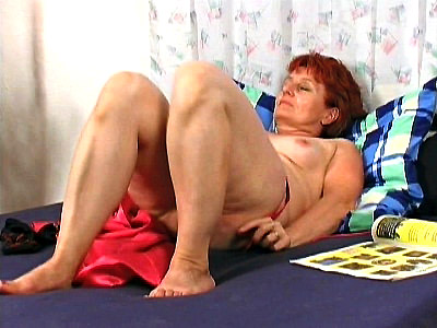 Hannys dyed red hair should give you a clue about her feisty slutty attitude This mature babe knows what she wants and she doesnt hold back when she wants it Just watch as she seduces a hot black stud by pushing a dildo deep into her sopping wet pussy