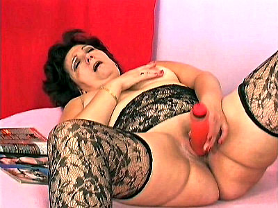 Emily looked good enough to eat in her lacy black lingerie and stockings I mean this hot grannys yummy curves were spilling out asking to be fondled It is such a shame that she has to settle for a dildo but she doesnt know that we have a little surprise for her